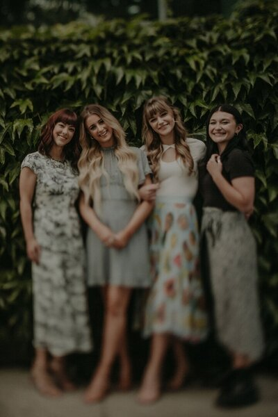 photo of four women smiling