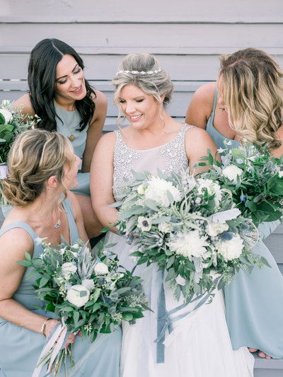 Bride and bridesmaids holding their flower bouquets