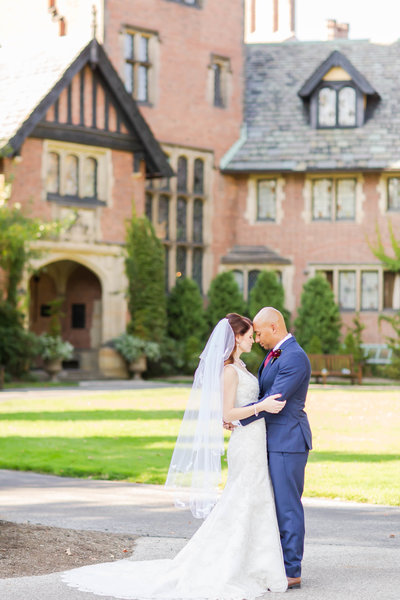 Bride and groom standing in front of Stan Hywet  photographed by photographer akron ohio loren jackson photography