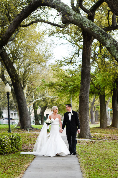 Couple under the oaks at their Mississippi Gulf Coast wedding