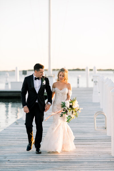 Refined and authentic fine art wedding with Monique Lhuillier wedding gown, black tie, organic florals, and sunset portraits on the water in Bay Head New Jersey by Liz Andolina Photography