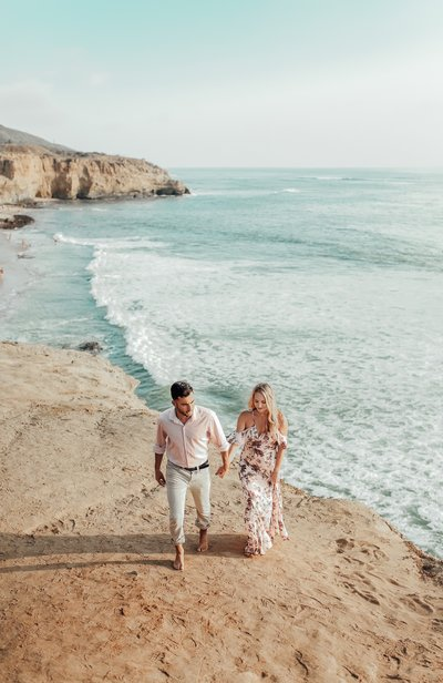 photo of bree and stephen at sunset cliffs taken by dakai photography