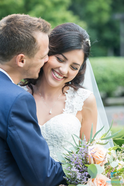 Smiling bride with her groom at the Pen Ryn Estate in Bucks County PA