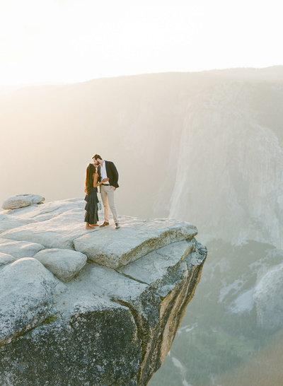 64-KTMerry-destination-engagement-photography-Yosemite-cliff-kissing