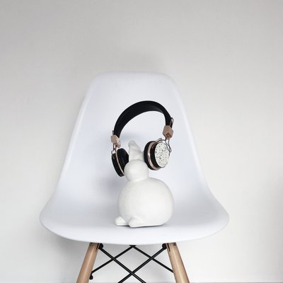 Ceramic bunny with headphones on a white chair