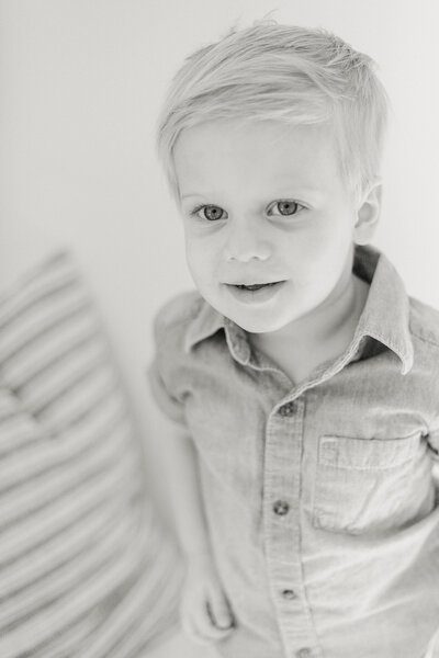A black and white portrait of a toddler by Rochester family photographer Emi Rose.