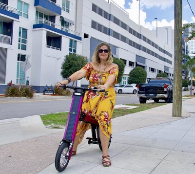 V&D Electric Bikes, Lady cruising around on her Purple Go-BIke M2