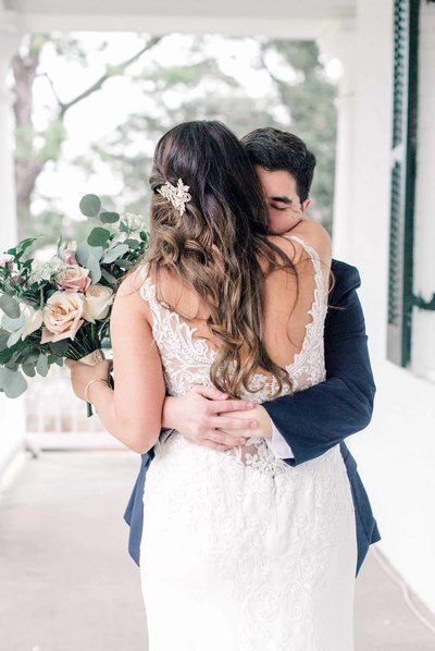 couple embracing before wedding