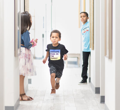 Kid running in children's dental office in Frisco Texas Thrive Dental