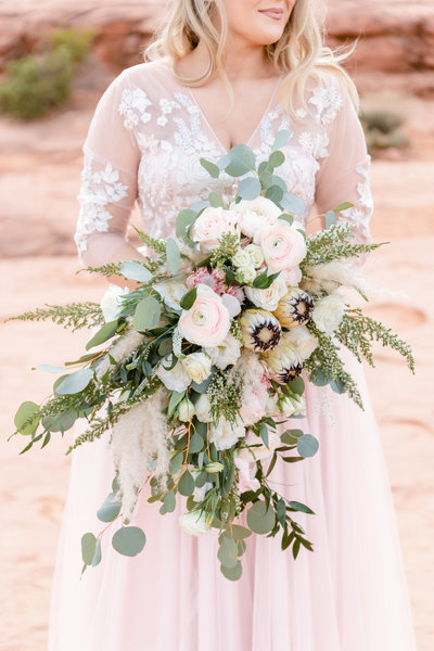 A bride holds a bouquet during her elopement