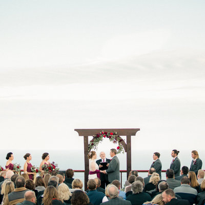 film photography of marriage ceremony on deck on top of a mountain overlooking lake supeiror