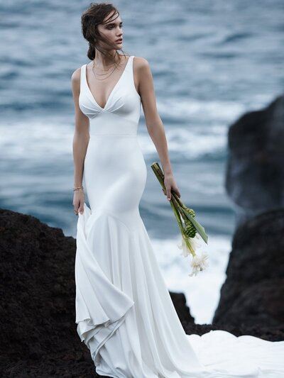 Simple Halter Back Mermaid Wedding Dress. Minimalist bridal can feel humdrum or hypnotic. We file this simple halter-back mermaid wedding dress under the latter.