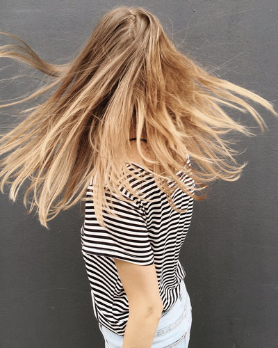 Canva - Woman Wearing Black and White Stripe Blouse