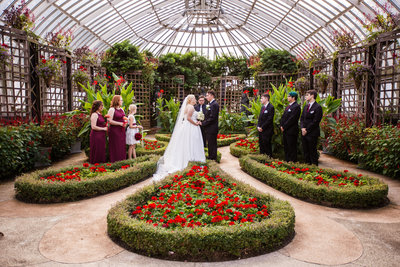 Wedding ceremony in the Broderie Room of  Phipps Conservatory