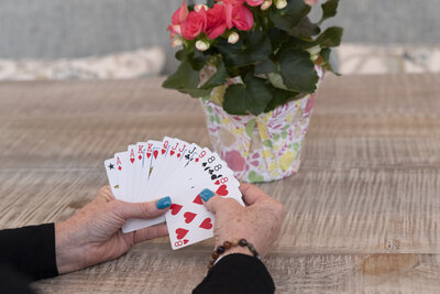 Hands holding deck of cards