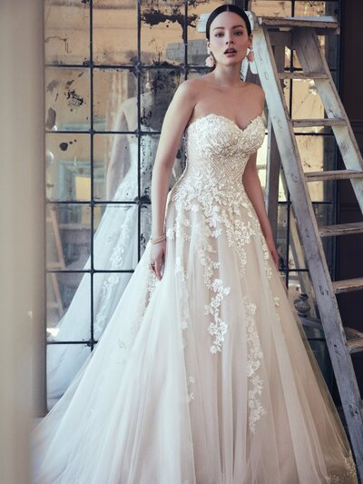 Lace Ball Gown Wedding Dress Favorite This lace ball gown wedding dress is designed to shimmer under light, be it dappled sunlight, a starry evening, rustic candles, or disco ball.