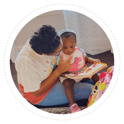 young black woman and toddler reading together