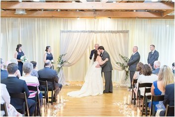ceremony first kiss for wedding at huguenot loft in Greenville