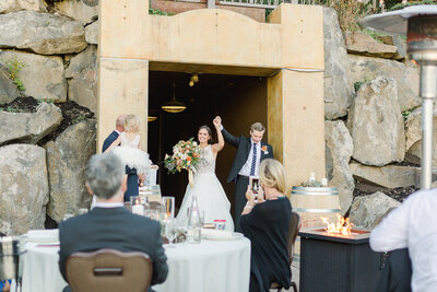 bride and groom enter reception at swiftwater cellars
