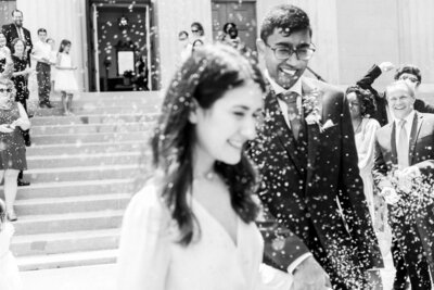 Couple laughing in black and white portrait for lavender toss wedding exit