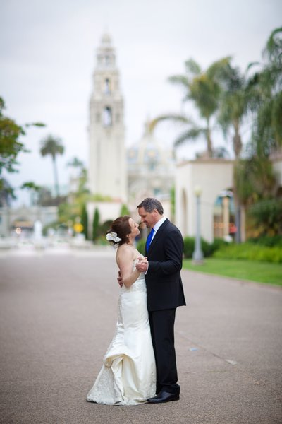 Bride and Groom dancing in street in Balboa Park wedding venue