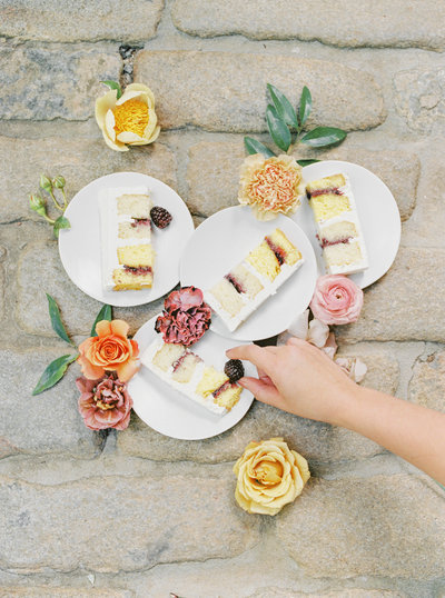 Slices of wedding cake decorated in fresh flowers