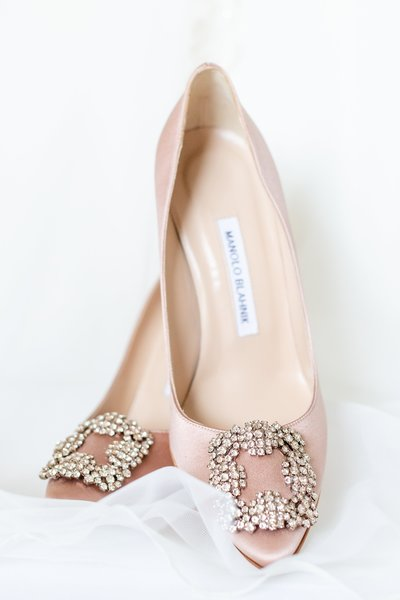 A pair of elegant Champaign satin wedding shoes designed by Manolo Blahnik