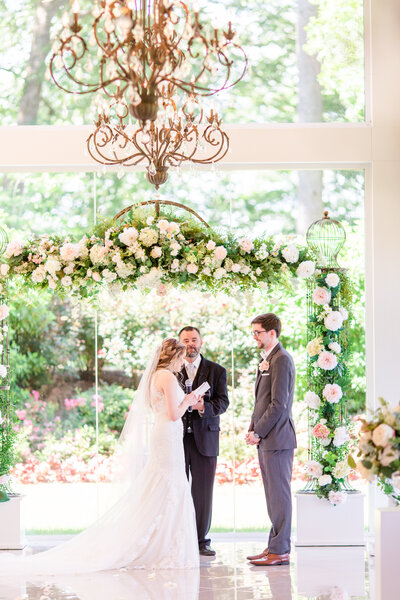 Photo of a couple's wedding ceremony at the Tate House in Georgia by Jennifer Marie Studios.