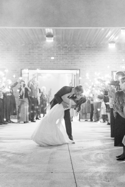 Bride & Groom share a kiss as they exit through sparklers