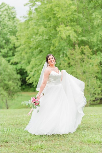 Summer bride twirling in wedding dress at Coopers Cove