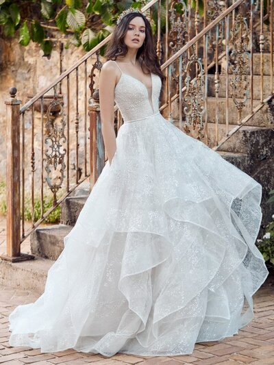 Sequin Tulle Ball Gown Wedding Dress. For brides-to-be who get ready with the help of singing cartoon animals: a sequin tulle ball gown wedding dress inspired by our favorite fairytale heroines.