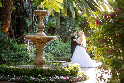 Bride and Groom in front of fountain at Grand Traditions Estate