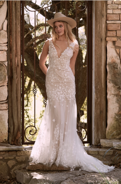 Fleur lace delicately cut and placed to create 3-D dimension on this V-neck fit and flare gown.