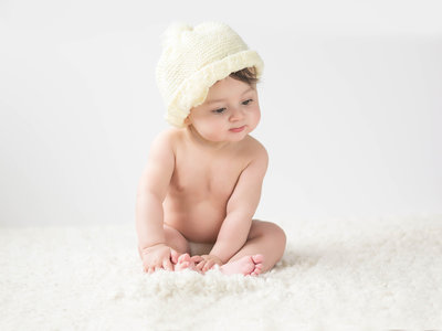 baby-in-yellow-hat-6-months-1200x800