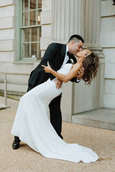 groom dips bride during their first look at the larz anderson house in washington dc