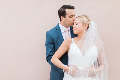 Charleston Bride in Hayley Paige Decklyn Wedding Dress and Veil with Groom in Navy Blue Suit with Blush Pink Tie