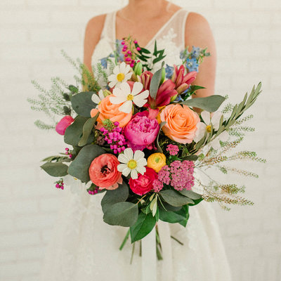 eucalyptus, pink peony and pale blue flowers