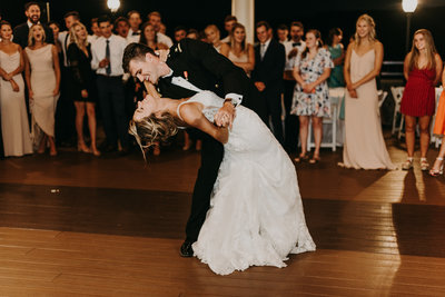 groom dips bride megan coolbaugh during their first dance at the house mountain inn in lexington virginia