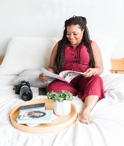 Branding image reading in the bed black female