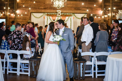 Couple Kisses after ceremony at The Venue at Southern Oaks in Mississippi