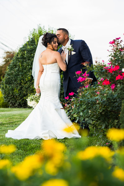 Bride and groom kiss outside the Falls Manor venue in Bristol PA