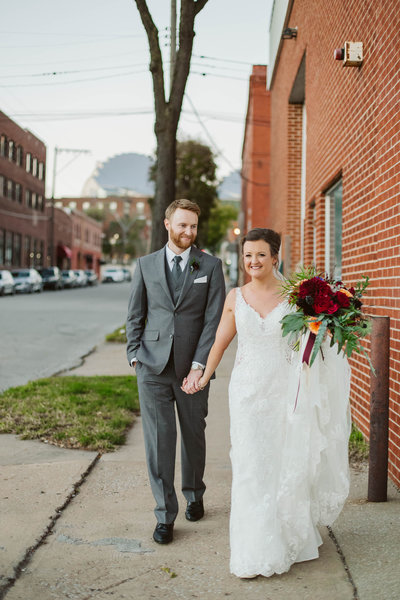 kansas-city-wedding-bride-groom-the-everly-event-space-red-flowers
