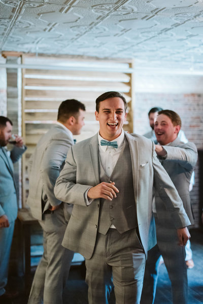 groom-laughing-the-ravington-groomsmen