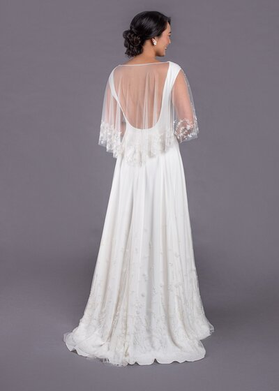 Back view of the Dolores wedding dress with its beaded bridal cape