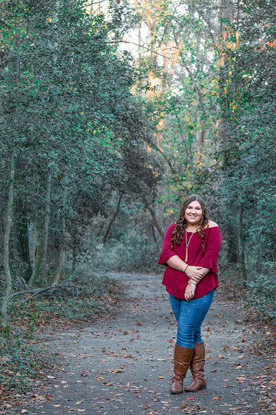 A senior poses in a wooded trail in Broad River, Shelby, North Carolina.
