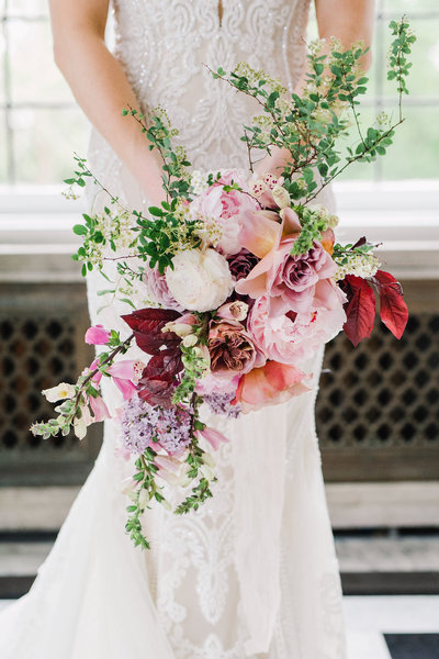Combination of pink & red florals for a bride's bouquet