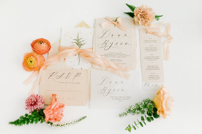 peach wedding invitation with calligraphy