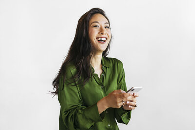 VA Studio-Female Business Owner with Phone in Hand