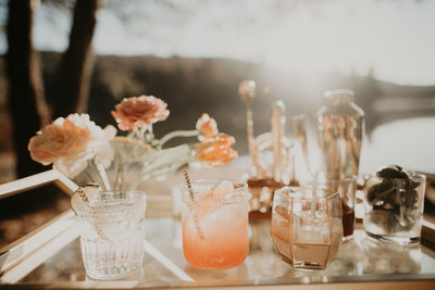 drink sitting on table with flowers