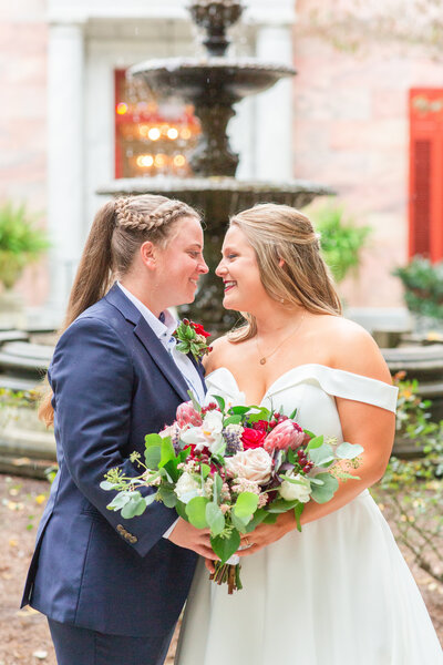 A photo of two brides at their wedding at the Tate House by Atlanta's best wedding photographer Jennifer Marie Studios.
